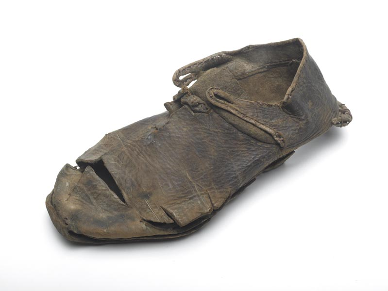 Brown leather shoe with a slash across the toe and along the side to make room for foot deformities.