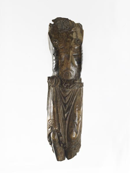 Walrus ivory crucifix. All that remains is Christ's torso and legs. He is bare chested and wears a belted cloth around his waist, which falls in folds to his knees.