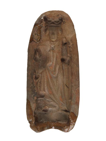 Oval-shaped terracotta mould of St Catherine. She is wearing a long robe and holds her wheel in her right hand.