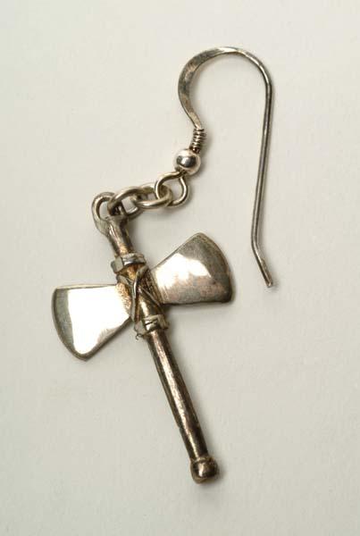SIlver earring in the shape of a double-headed axe.