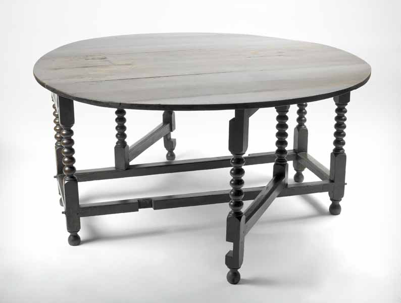 Photograph: round, wooden gate-legged table used by the Fire Court judges.