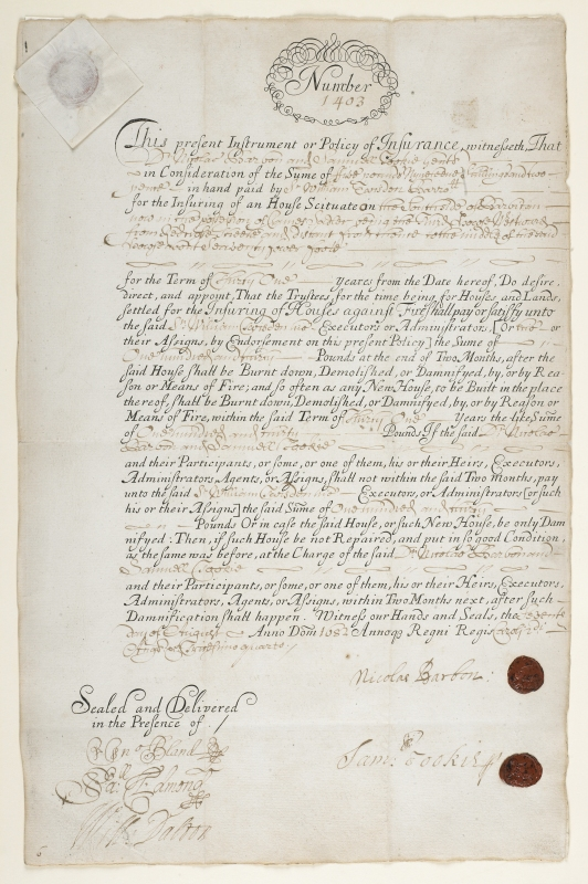 Photograph: handwritten document with a signature and 2 red wax seals at the bottom.